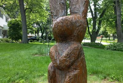 wooden rabbit carved from tree
